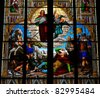 Stained glass window depicting the This window is located in the Dom of Cologne. - stock photo