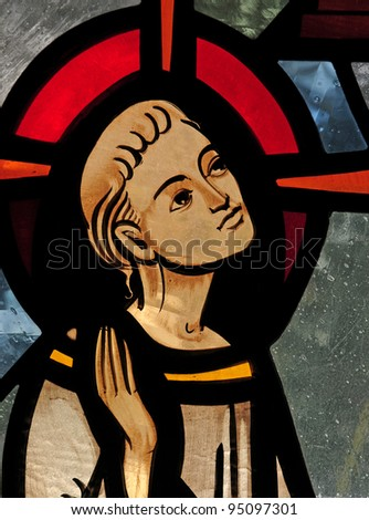 Stained glass window detail of face of the child Jesus teaching in the temple - stock photo