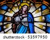 Stained glass window detail of the virgin Saint Mary - stock photo
