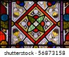 Stained glass window - geometric pattern A Victorian stained glass window with a geometric pattern.  On public display for over 100 years. - stock photo