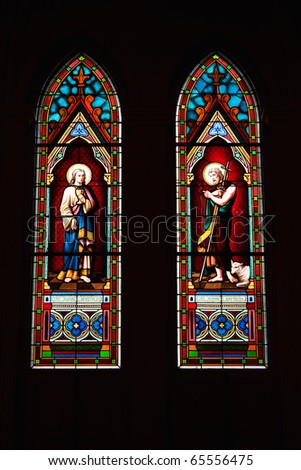 Stained glass window in catholic church - stock photo