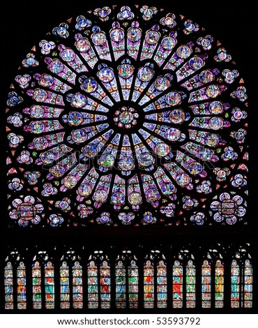 stained glass window in Notre dame cathedral, Paris, France - stock photo