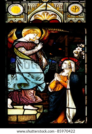 Stained glass window in St. Nikolai church (Orebro, Sweden) is depicting St.Gabriel who announces the Blessed Virgin Mary God's plan for her to be the Mother of His Son, Jesus. - stock photo