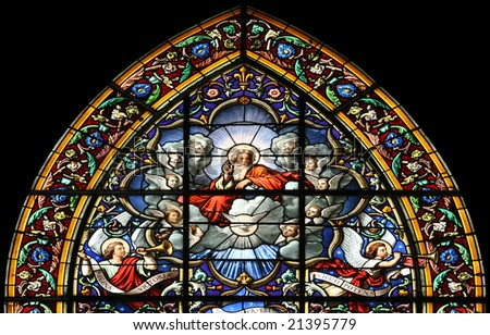 Stained glass window in St.Sulpice church ( Fougeres, France), depicting The Lord God Almighty  and Angels in Heaven. - stock photo