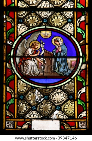 Stained glass window in St.Victor church ( Castellane, France), depicting  St.Gabriel who announce the Blessed Virgin Mary God's plan for her to be the Mother of His Son, Jesus. - stock photo