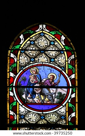 Stained glass window in St.Victor church (Castellane, France) depicting the Holy Family. - stock photo