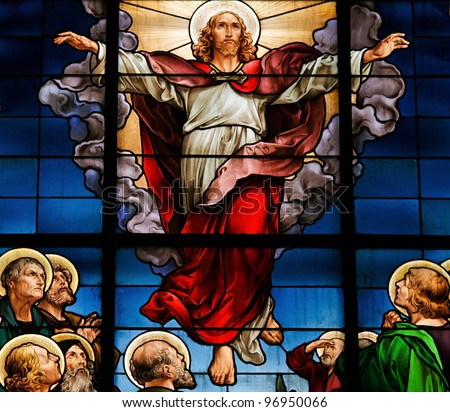 Stained glass window in the German Church in Stockholm Sweden, depicting the Ascension of Christ. - stock photo