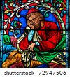 Stained glass window in the Notre Dame Cathedral in Paris, created in the 13th Century, depicting a resting person. - stock photo