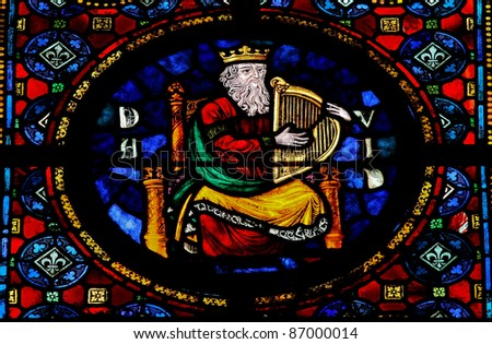 Stained glass window in the Notre Dame church of Dinant, Belgium, depicting the Hebrew king David. - stock photo