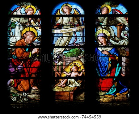 Stained glass window in the Saint-Eustache church in Paris depicting a Nativity Scene. - stock photo