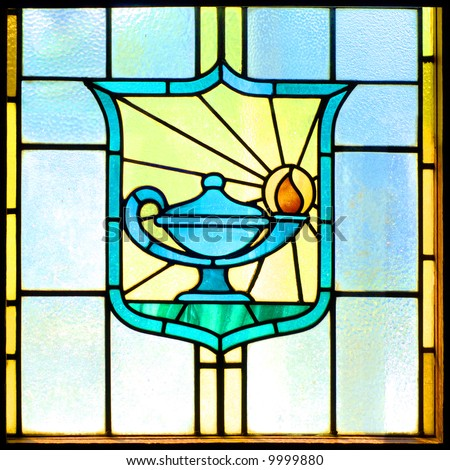 Stained glass window of a lamp - stock photo