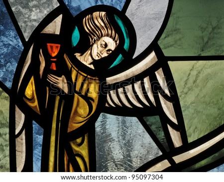 Stained glass window of angel holding chalice