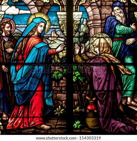 Stained glass window of bible story of the Feast of the Visitation, with the Blessed Virgin Mary visiting Elizabeth