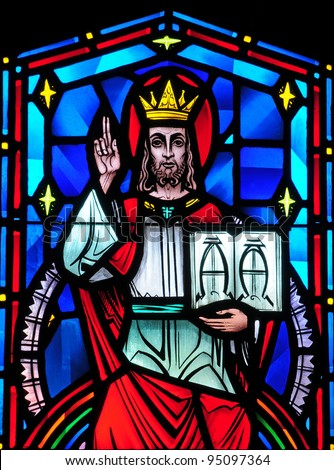 Stained glass window of Christ the King, Alpha and Omega - stock photo