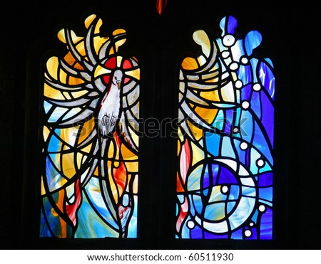 stained glass window of dove - stock photo