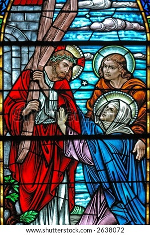 Stained glass window of Jesus carrying cross from 1899 - stock photo