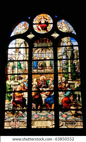 Stained glass window of Saint Etienne church in Paris - The Last Supper - stock photo