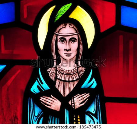 Stained glass window of St. Kateri Tekakwitha,  known as Lily of the Mohawks, a Native American saint canonized in 2012 and patron of the environment and ecology - stock photo