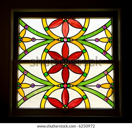 Stained Glass Window of Stylized Red and Yellow Flowers - stock photo