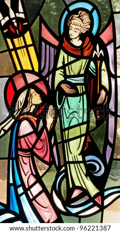 Stained glass window of the Annunciation to Mary by the Angel Gabriel - stock photo