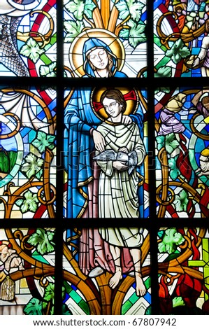 Stained Glass window of the Blessed Mother Mary and Christ Child Jesus - stock photo