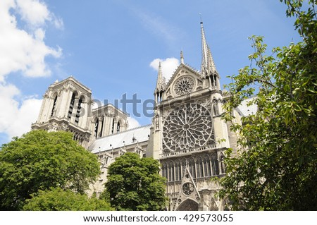 Stained glass window of the Cathedral of Notre Dame de Paris, France - stock photo