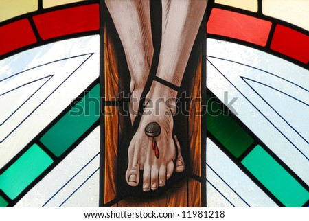 Stained glass window of the crucifixion of Jesus - stock photo