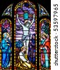 Stained glass window of the crucifixion scene - stock photo