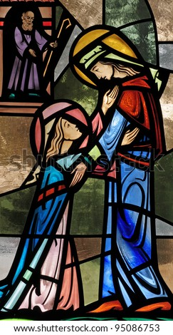 Stained glass window of the Visitation, Mary visiting Elizabeth - stock photo