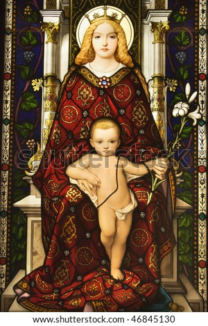Stained glass window showing image of Madonna and Child. Vertical shot. - stock photo