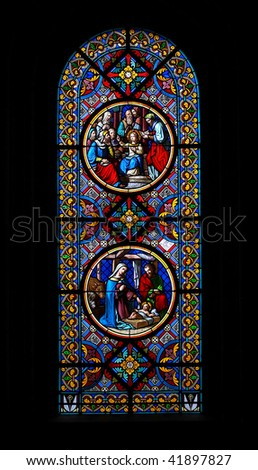 Stained-glass window with Christmas scenes in the Basel  Munster (Switzerland). - stock photo