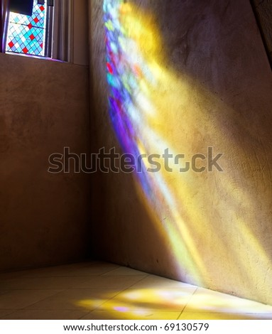 Stained Glass window with sun rays of colored light on wall and floor. St. Giles Cathedral. Edinburgh. Scotland. UK. - stock photo