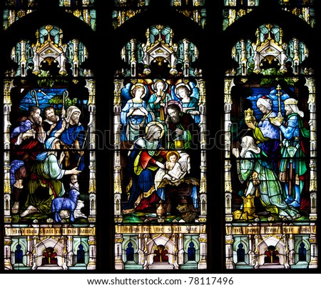 Stained glass windows at church reflecting religious figures - stock photo