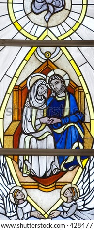 Stained glass windows in a church. Christ, Mary and angels - stock photo