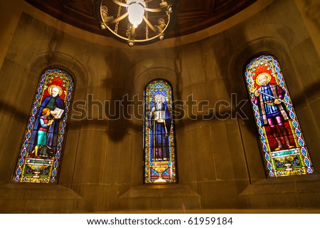 stained-glass windows in Basilica at the Montserrat Monastery in the mountains near Barcelona, Catalonia, Spain - stock photo