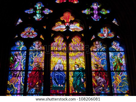 Stained glass windows of St. Vitus in Prague, Czech Republic. - stock photo