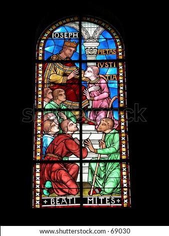 Stained glass windows of the cathedral of Perigueux, France. - stock photo