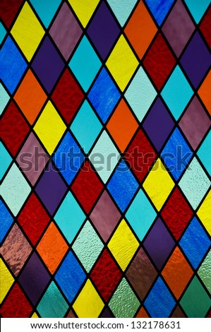Stained glass with multi-colored diamond pattern - stock photo