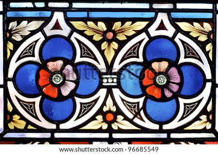 stained glass with two red flowers in Prague - stock photo