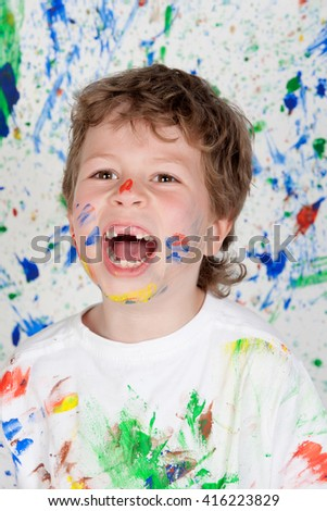 Stained paint with his mouth open child without teeth - stock photo