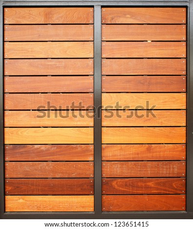 Stained wood framed in steel garage doors vertical - stock photo