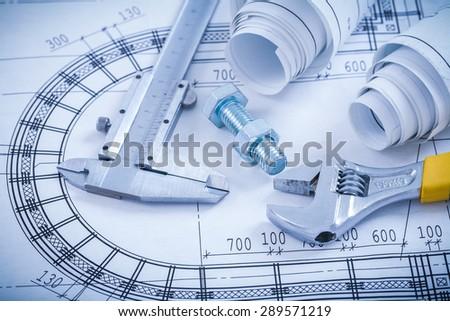 Rolled construction blueprints building concept stock for Architecture design blueprint