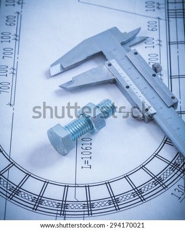 Stainless bolt with screw nut roller bearings on blueprint construction concept. - stock photo