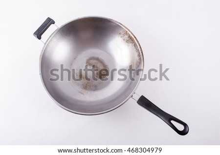 stainless old chinese wok pan isolated white