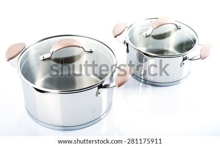 Stainless pots  on a white background.Selective focus.Little of DOF