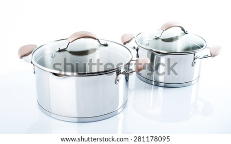 Stainless pots  on a white background.Selective focus.Little of DOFF