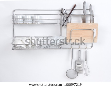 Stainless shelf with kitchen utensil on the white background - stock photo