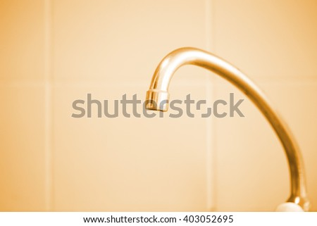 stainless sink tap in the kitchen color vintage - stock photo