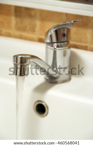 Stainless steel bathroom tap. Bathroom faucet.