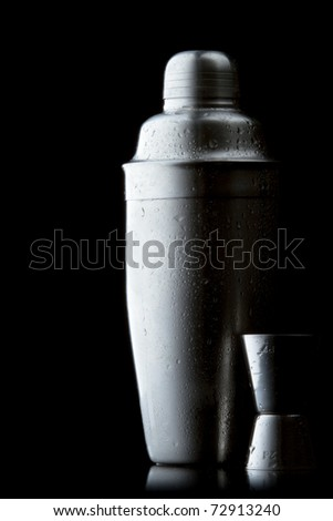 stainless steel cocktail shaker on a red gradient - stock photo
